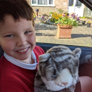 Hayley's son, Aidan, with her cuddly cat Fast Entry Prize