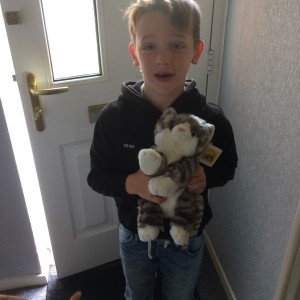 Rhys, the Grandson of Joan Jones, with a cuddly cat fast entry prize